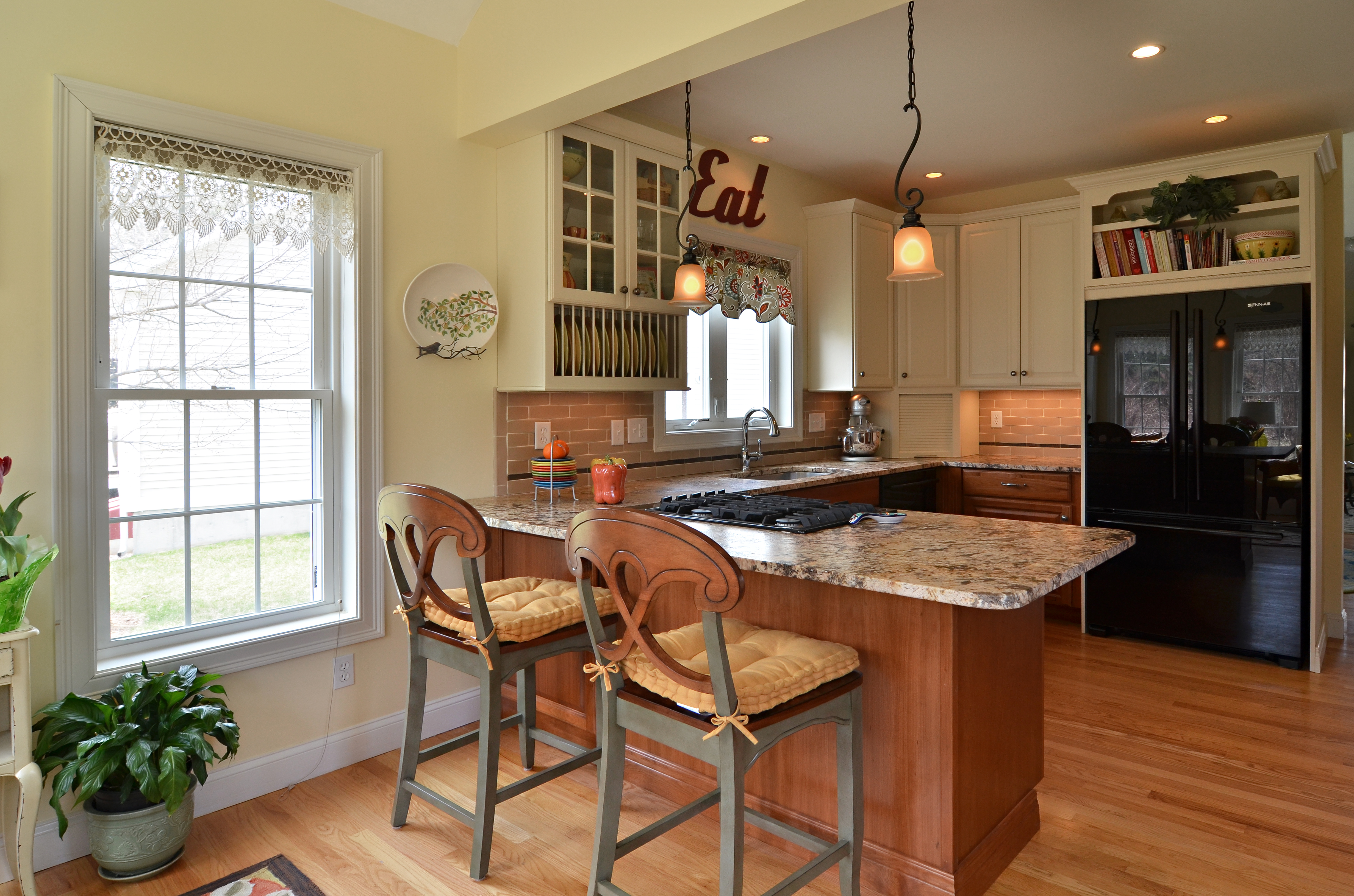 Combine small kitchen and sun room to create a spacious entertaining